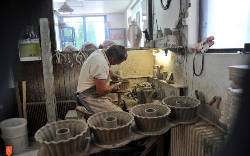 A potter Franc Kremžar while making traditional pottery.