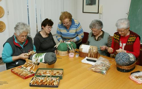 Members of the Bobbin lace Association Cvetke Žiri while making bobbin laces.