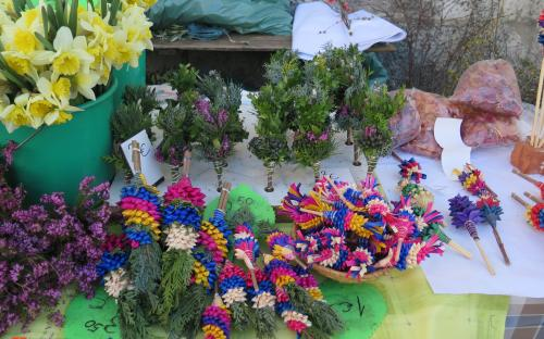 Selling Palm Sunday bunches from Ljubljana area at the marketplace.