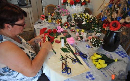Anica Tomšič while making paper flowers.